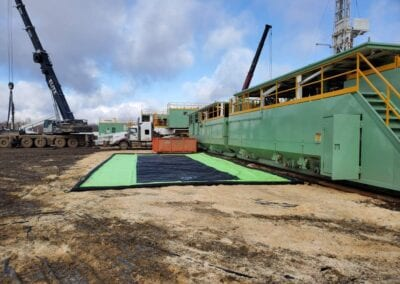HydraTrax-drive-over-spill-containment-on-oilfield-lease